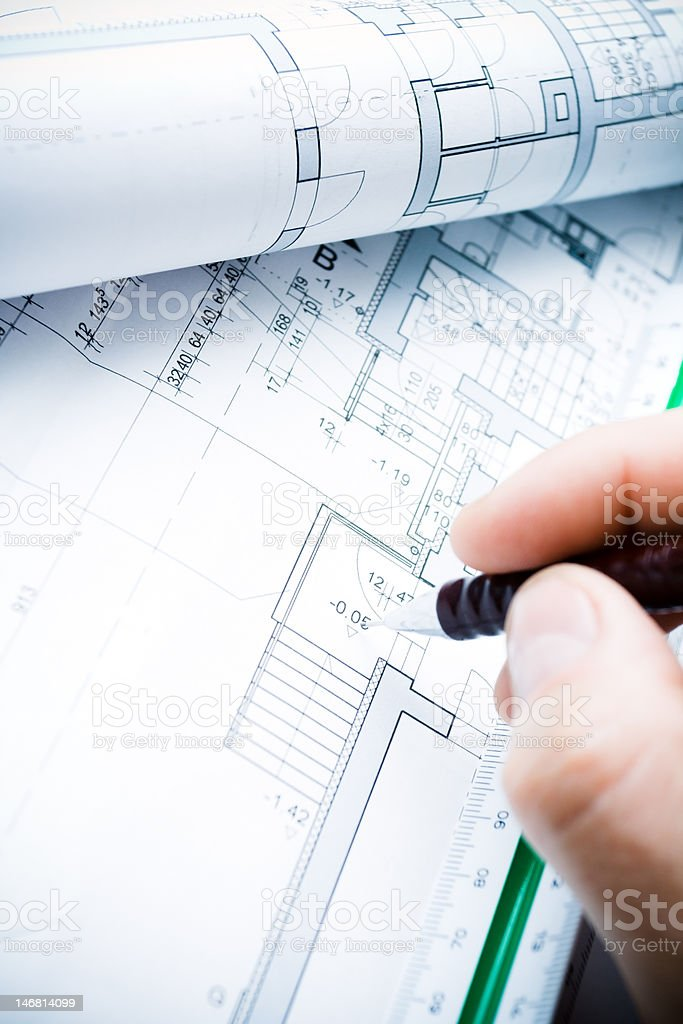 Architect working on blueprints royalty-free stock photo