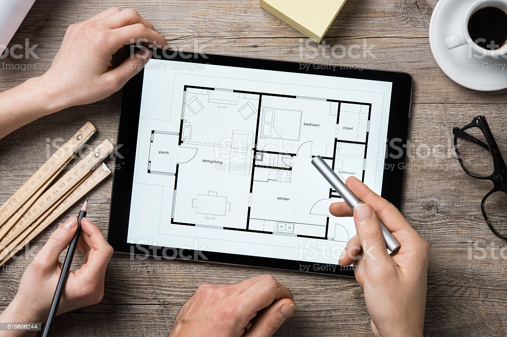 Architect working on digital tablet stock photo