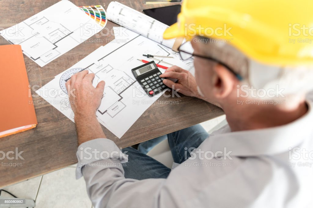 Architect working on plans stock photo