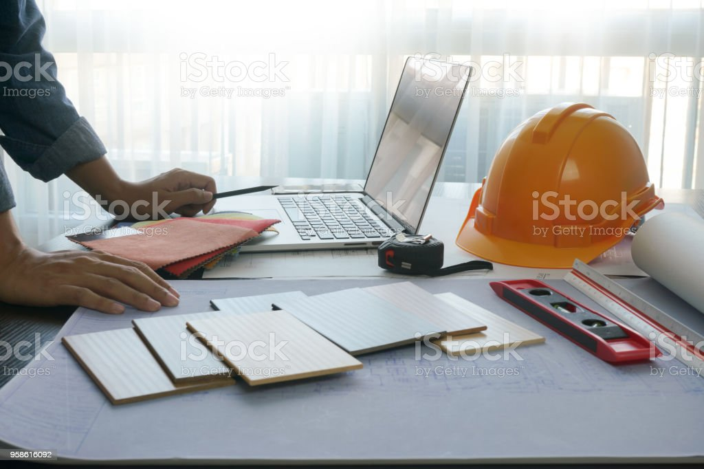 architect working on table with construction tools and material...