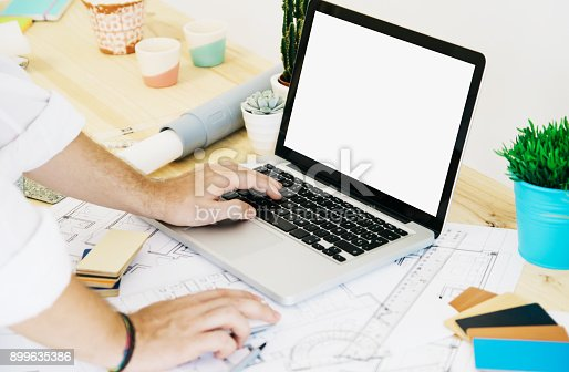 istock architect working with laptop 899635386