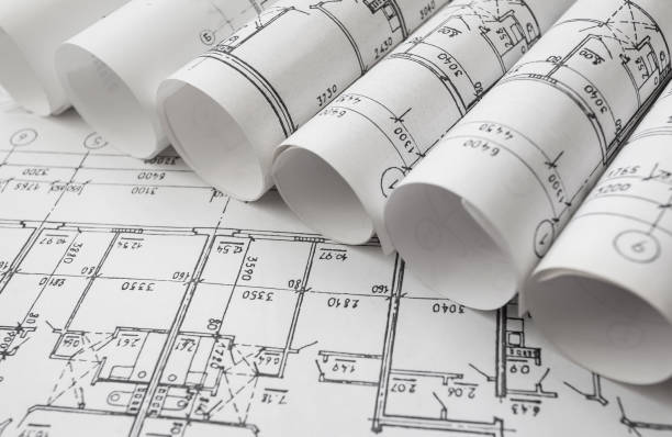 Architect workplace. Architectural project, blueprints, blueprint rolls on wooden desk table. Construction background. Engineering tools. Copy space – Foto