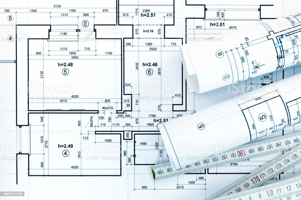 Architect workplace with measurement tools rolled blueprints and architect workplace with measurement tools rolled blueprints and project plan royalty free stock photo malvernweather Gallery