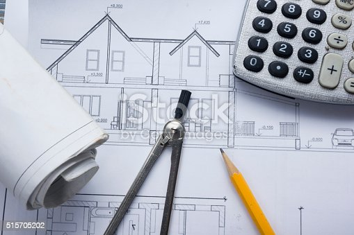 515801338 istock photo Architect worplace top view. Architectural project, blueprints, blueprint rolls and 515705202