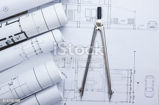 515801338 istock photo Architect worplace top view. Architectural project, blueprints, blueprint rolls and 515705758