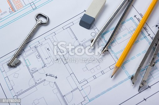 515801338 istock photo Architect worplace top view. Architectural project, blueprints, blueprint rolls and 515792010