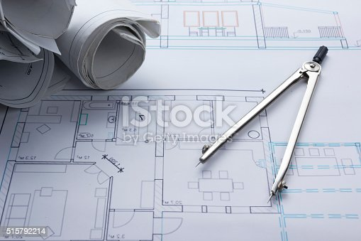 515801338 istock photo Architect worplace top view. Architectural project, blueprints, blueprint rolls and 515792214