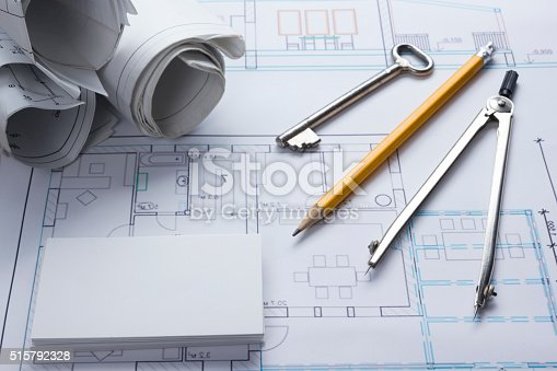515801338 istock photo Architect worplace top view. Architectural project, blueprints, blueprint rolls and 515792328