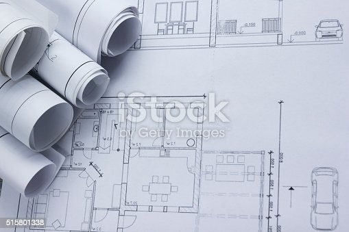 515801338 istock photo Architect worplace top view. Architectural project, blueprints, blueprint rolls on 515801338
