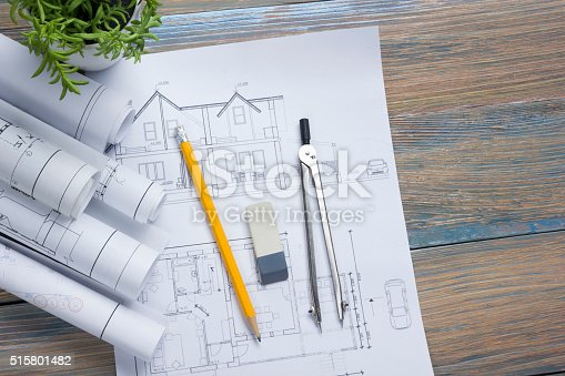 515801338 istock photo Architect worplace top view. Architectural project, blueprints, blueprint rolls and 515801482