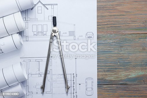 515801338 istock photo Architect worplace top view. Architectural project, blueprints, blueprint rolls and 515924990