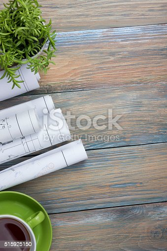 515801338 istock photo Architect worplace top view. Architectural project, blueprints, blueprint rolls and 515925150