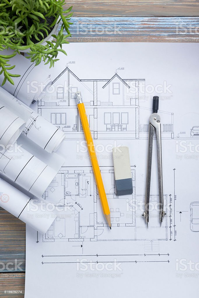 Architect worplace top view architectural project blueprints architectural project blueprints blueprint rolls and royalty free malvernweather Gallery