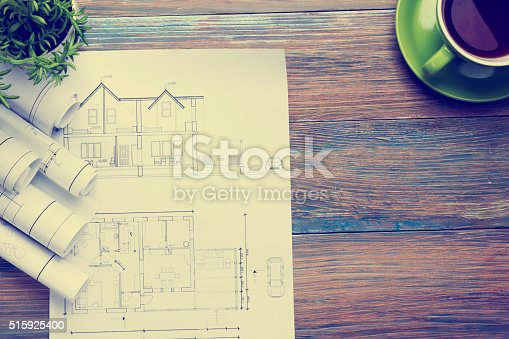515801338 istock photo Architect worplace top view. Architectural project, blueprints, blueprint rolls and 515925400