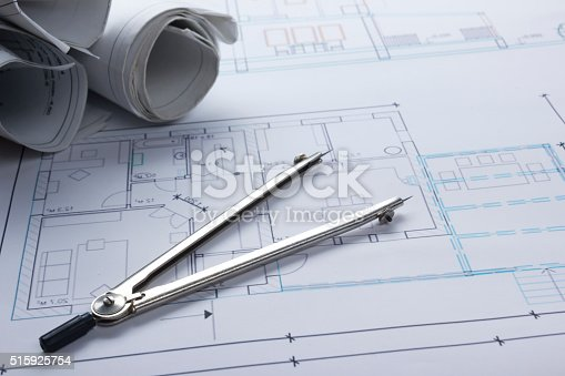 515801338 istock photo Architect worplace top view. Architectural project, blueprints, blueprint rolls and 515925754