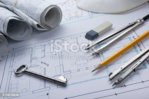 515801338 istock photo Architect worplace top view. Architectural project, blueprints, blueprint rolls and 515926638