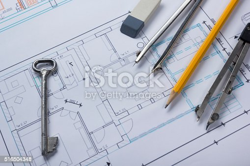 515801338 istock photo Architect worplace top view. Architectural project, blueprints, blueprint rolls and 516504348