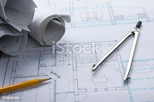 515801338 istock photo Architect worplace top view. Architectural project, blueprints, blueprint rolls and 516505450