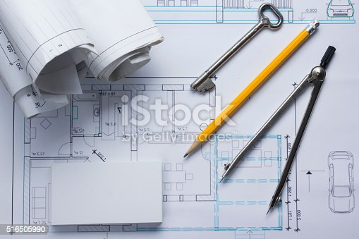 515801338 istock photo Architect worplace top view. Architectural project, blueprints, blueprint rolls and 516505990