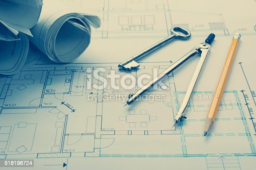 515801338 istock photo Architect worplace top view. Architectural project, blueprints, blueprint rolls and 518198724