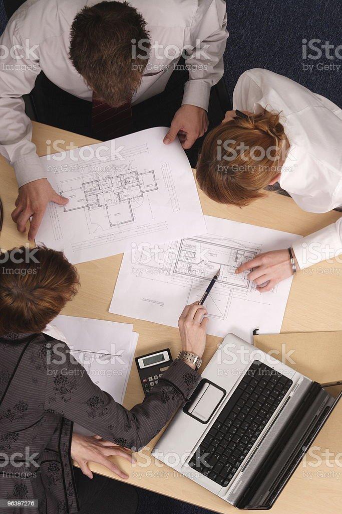 architect,clients,blueprints royalty-free stock photo