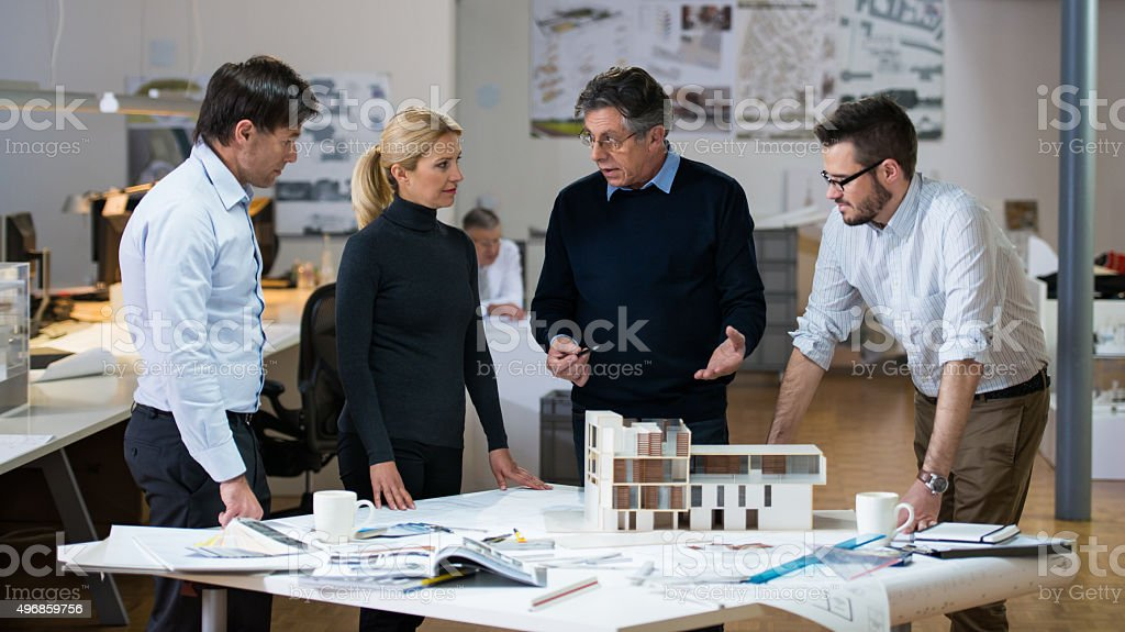 Architects and Custumer in Office stock photo