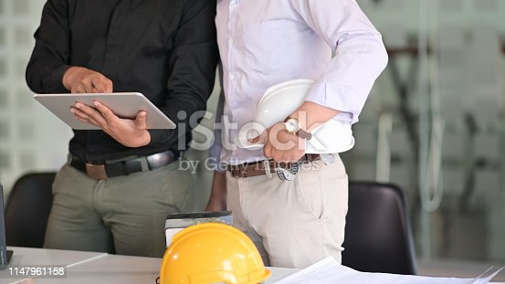istock Architects and Engineer team working with blueprints in office 1147961158