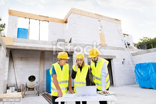 1166176793 istock photo Architects and worker at the construction site. 867366194