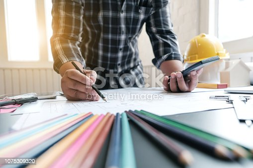 1174841541 istock photo Architects are drawing project at work. 1075309320