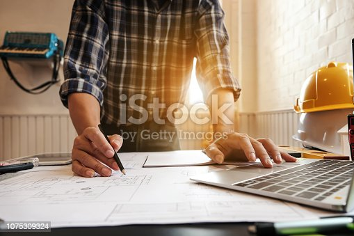 1174841541 istock photo Architects are drawing project at work. 1075309324