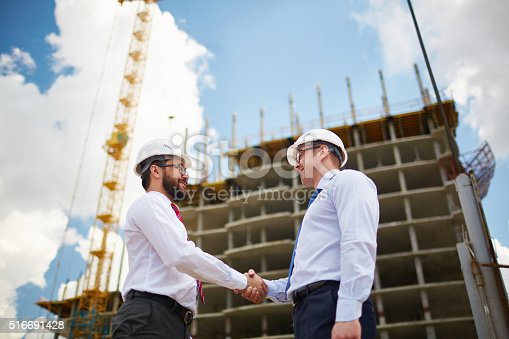 istock Architects at construction site 516691428