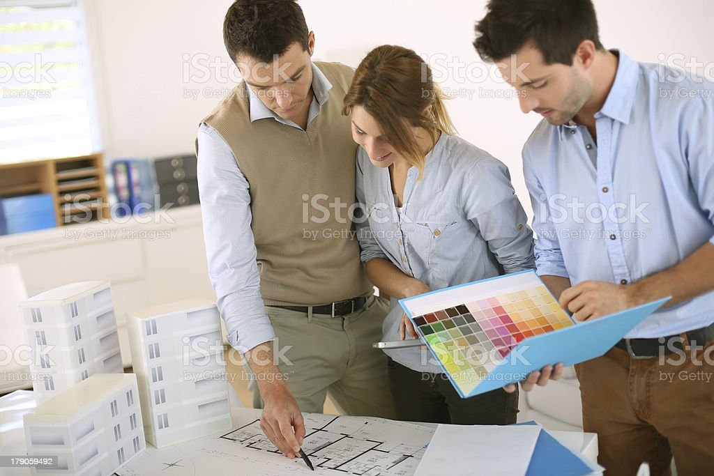 Architects checking plans in office royalty-free stock photo