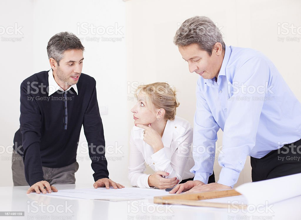 Architects considering a plan royalty-free stock photo