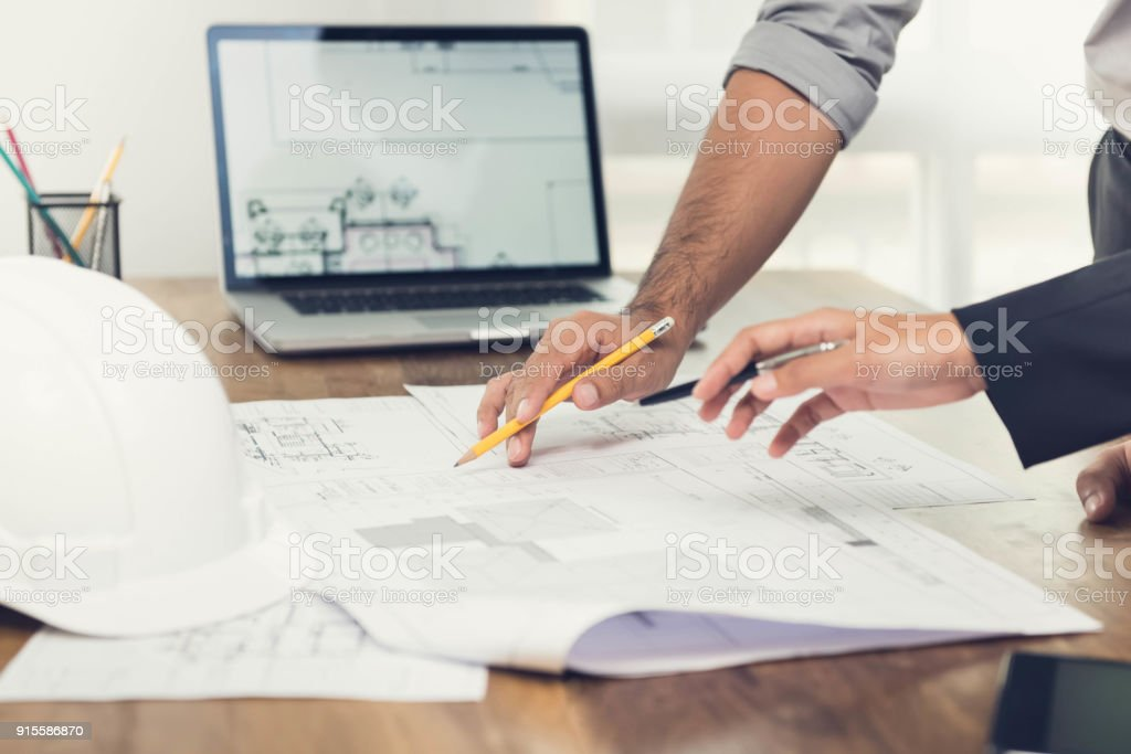 Architects discussing a project in the office royalty-free stock photo