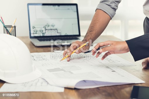 istock Architects discussing a project in the office 915586870