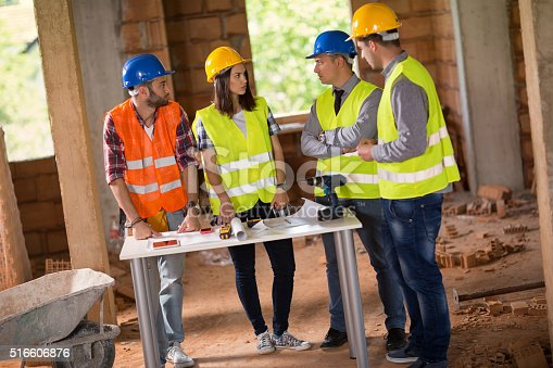 516607254 istock photo Architects discussing about blue print 516606876