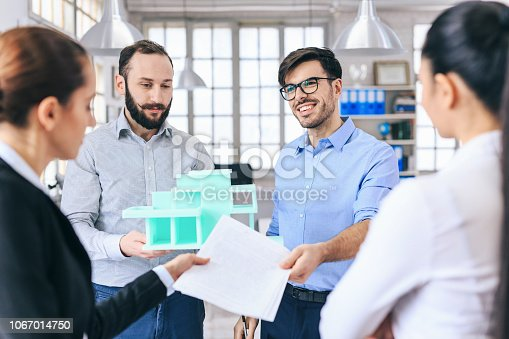 532257236istockphoto Architects discussing new project 1067014750