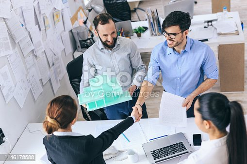 532257236istockphoto Architects discussing new project 1146178588