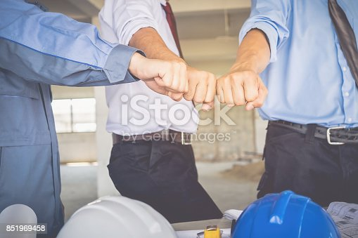 912867216istockphoto Architects, engineers and businessmen are fisting together. To work together as a team to work successfully. 851969458