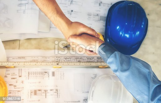 1055059750istockphoto Architects, engineers and businessmen are joining hands for unity. To work together as a team to work successfully. 912867216