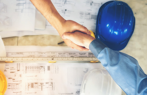 912867216 istock photo Architects, engineers and businessmen are joining hands for unity. To work together as a team to work successfully. 912867216