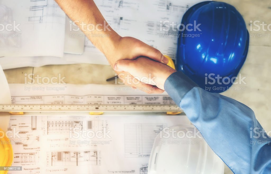 Architects, engineers and businessmen are joining hands for unity. To work together as a team to work successfully. stock photo