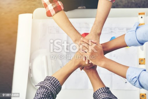 912867216istockphoto Architects, engineers and businessmen are joining hands for unity. To work together as a team to work successfully. 918813488