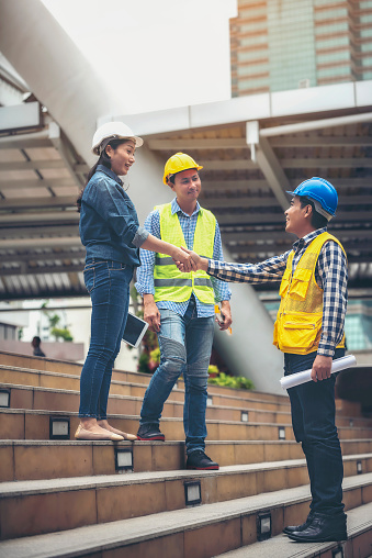 912867216 istock photo Architects, engineers and the team have agreed to work together hand in hand together to create jobs. 1011304260