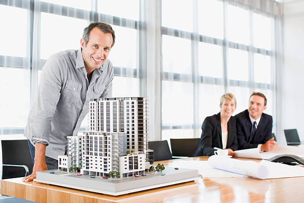 Architects in conference room with building model stock photo