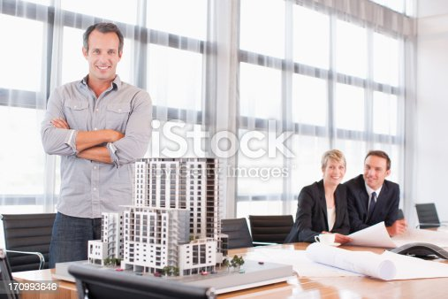 istock Architects in conference room with building model 170993646