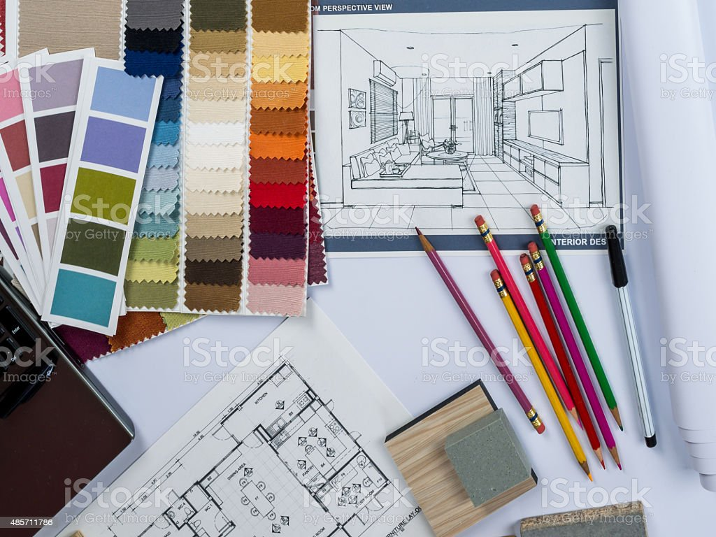 Architects- interior designer desk with laptop, shop drawing, material  sample - Stock image .