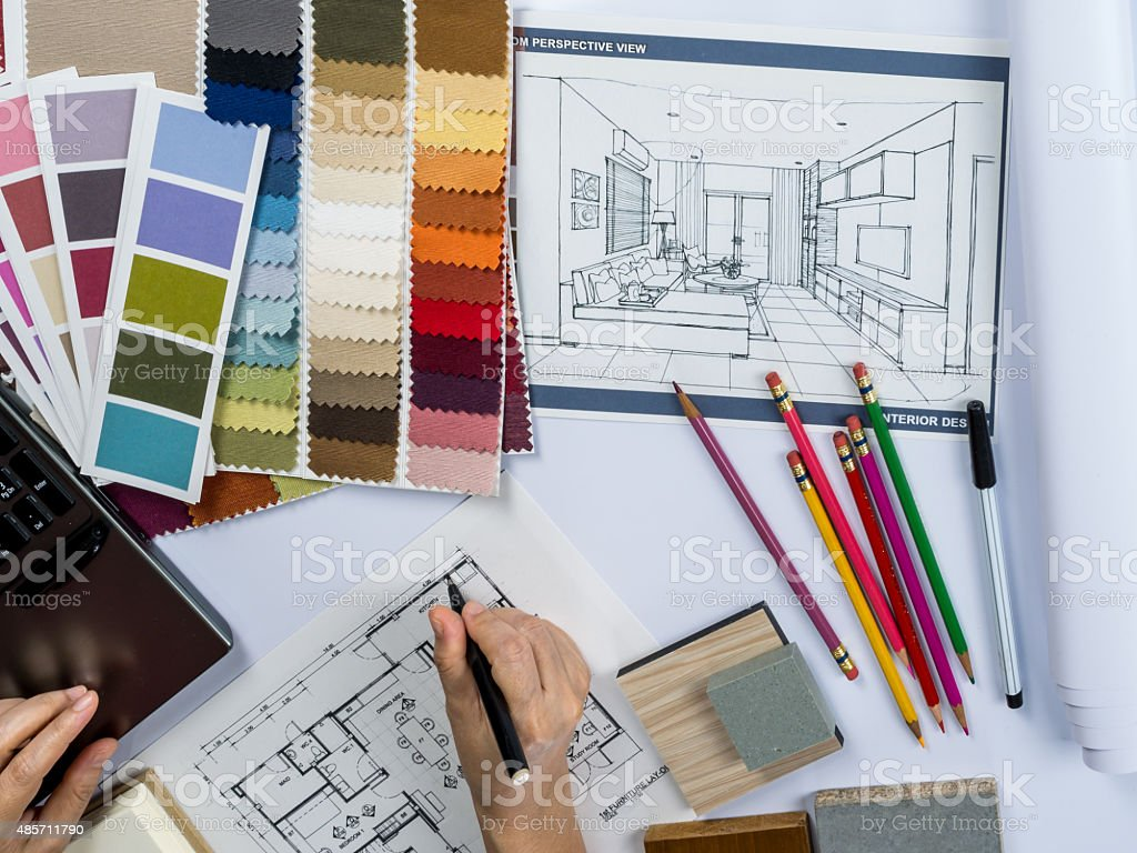 Architects/ interior designer hands  drawing of house on creative desk stock photo