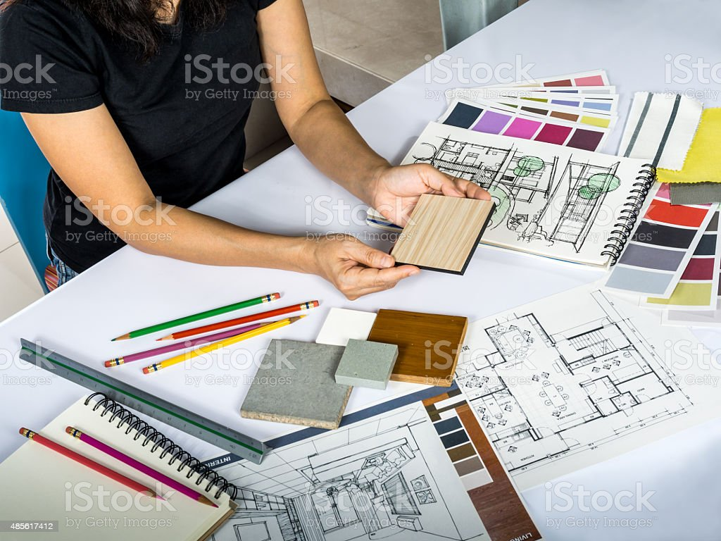 Architects/ interior designer hands working with shop drawing, material sample stock photo