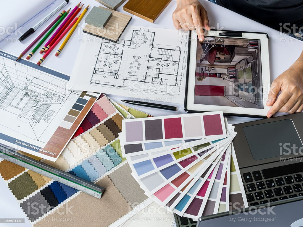Architects/ interior designer hands working with tablet computer, material sample stock photo